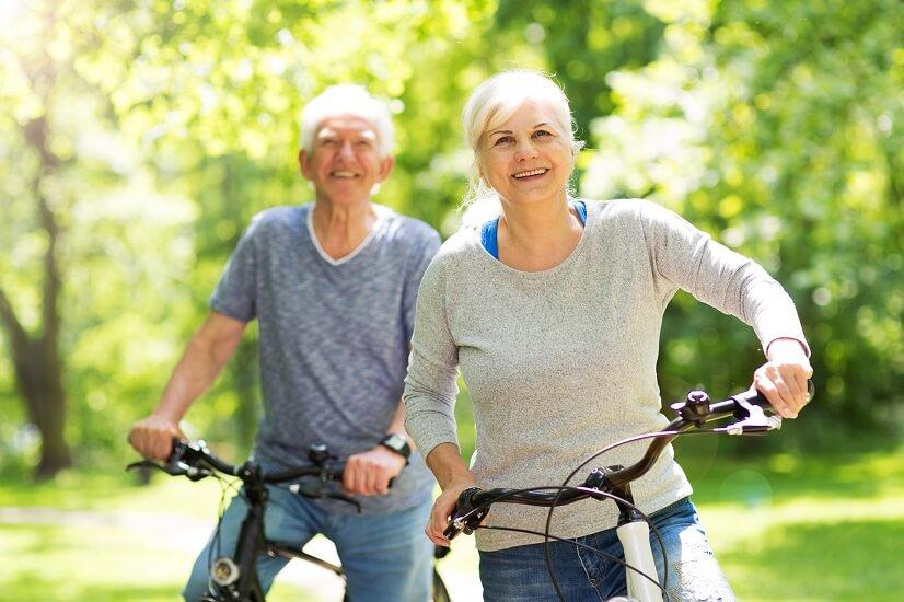 mature couple on bikes