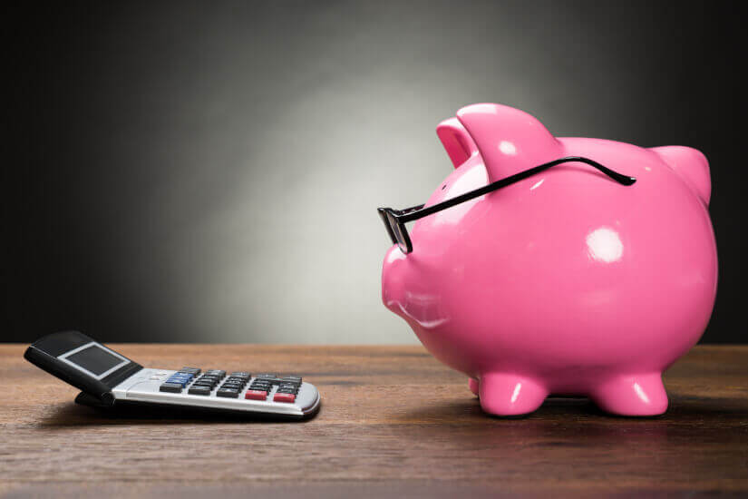 pink piggy bank looking at calculator age pension tighten rules retirement rules