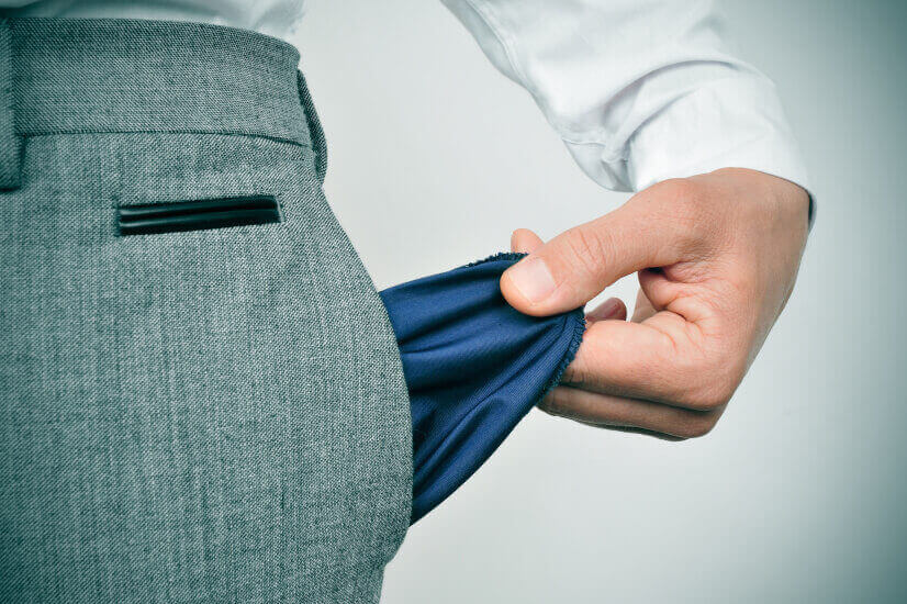 businessman holding empty pocket 10 professions most likely to go bankrupt