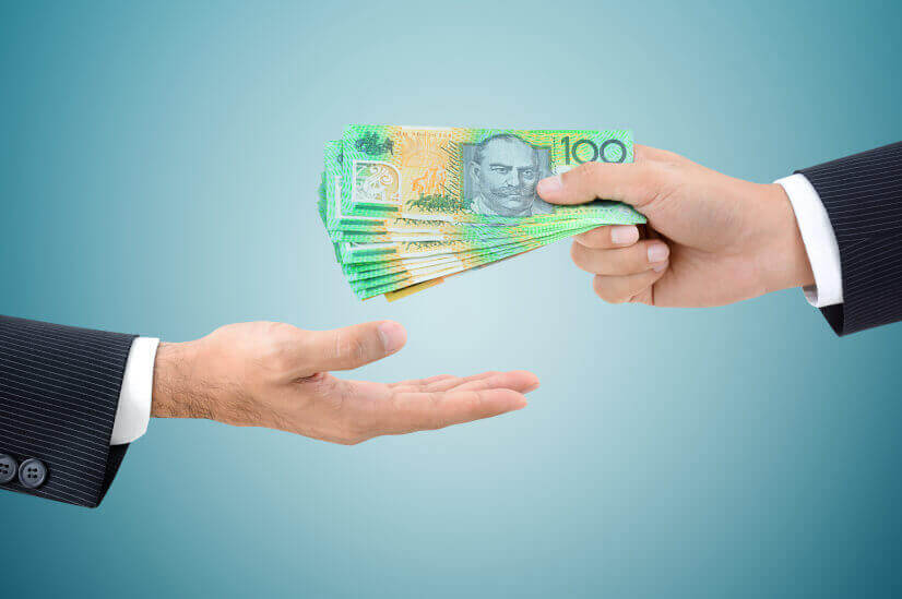 buy now pay later hands giving australian dollars cash money lender inquiry