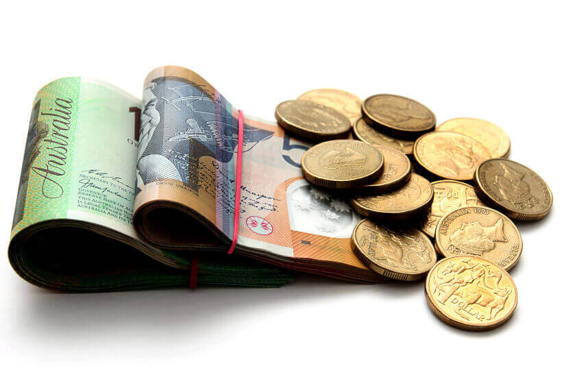 coin bundle of cash australian dollars savings experiment in kenya financial literacy education
