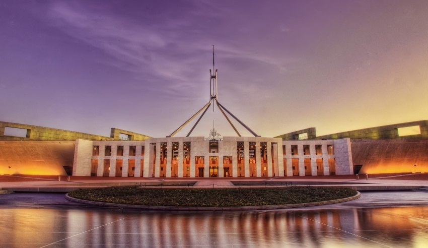 australian parliament house at sunset modern slavery act impact investment portfolio