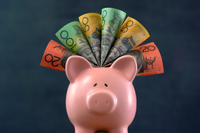 Piggy bank with Australian banknotes