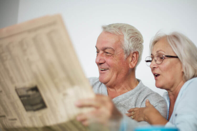old senior couple reading newspaper comprehensive income products retirement guide