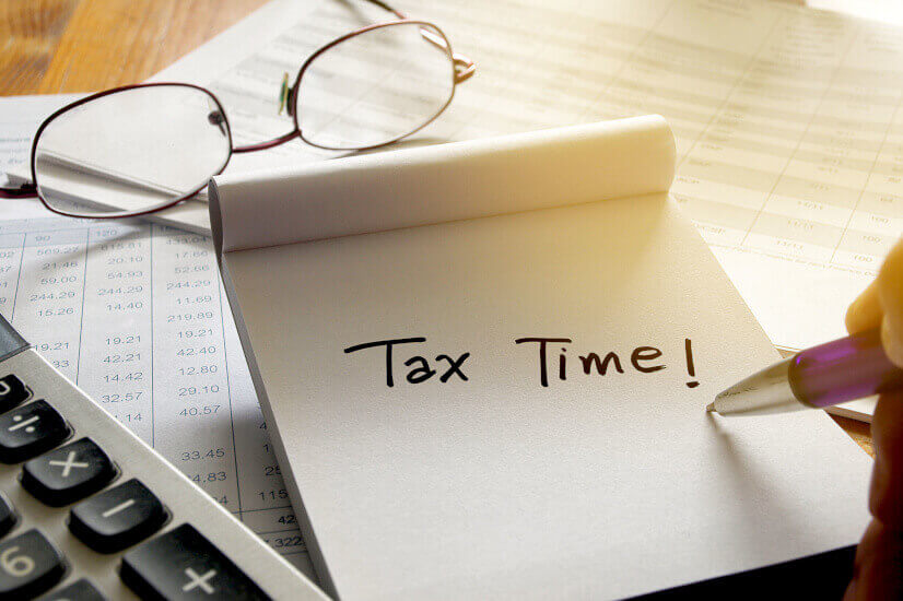 paper tax time glasses and calculator labor proposed changes to tax time