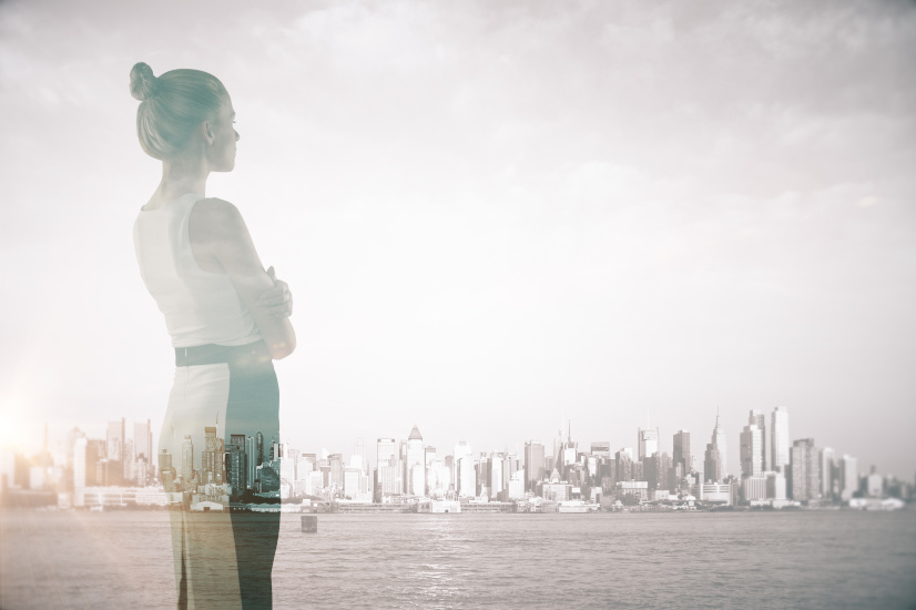Woman and city skyline