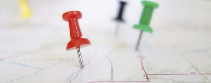 colored pins on map overseas global map moving overseas tax nightmare