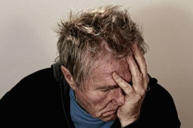 distressed man with head in hands